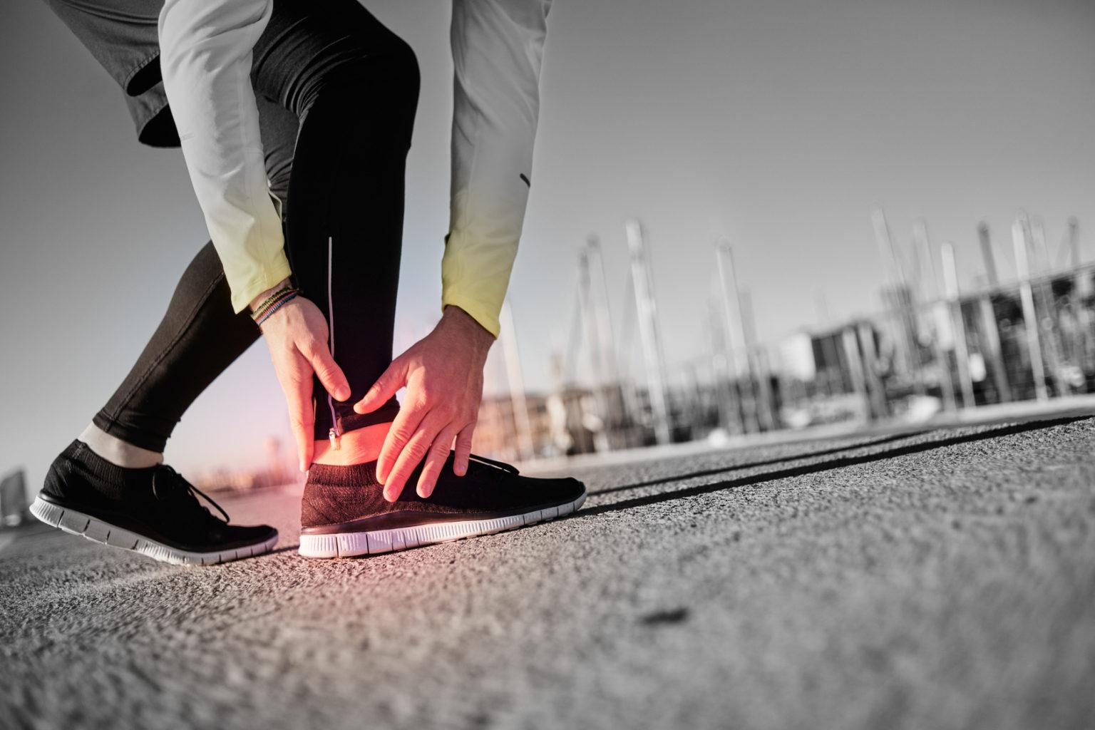 Broken twisted ankle - running sport injury. Athletic man runner