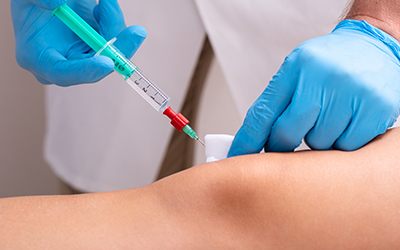 Doctor Makes Rejuvenation Beauty Injection On Woman's Knee