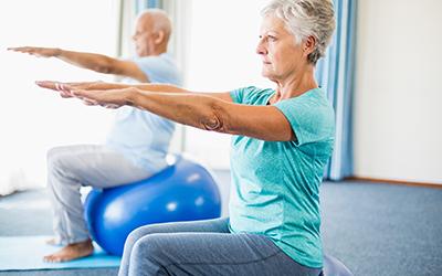 Seniors using exercise ball