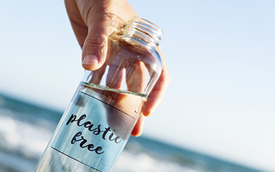 reusable water bottle with the text plastic free