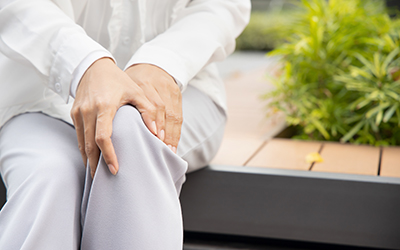woman with knee joint pain; muslim woman with hand holding injured knee; portrait of asian woman suffering from knee pain injury, girl with knee joint injury; young muslim woman health care model
