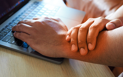 Asian Businessman people suffer from wrist pain hand and arm pai