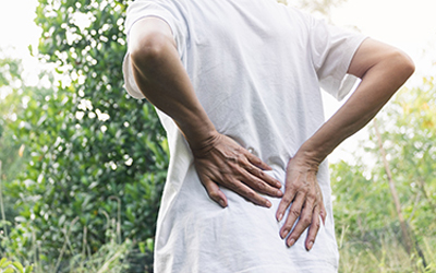 closeup hands of woman touching her back pain in healthy concept