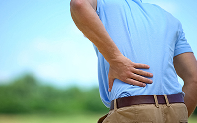 Male feeling sharp lower back pain outdoor, health and problems,