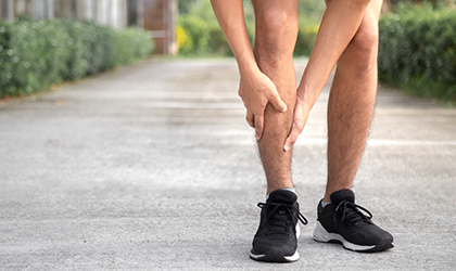 young runner is suffering from shin splints