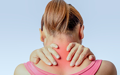 asian woman holding hand and touching skin around cervical spine