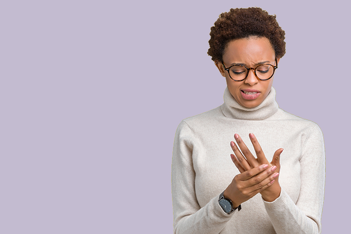 Young beautiful african american woman wearing glasses over isolated background Suffering pain on hands and fingers, arthritis inflammation