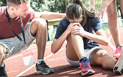 Female athlete getting injured during athletic run training - Ma