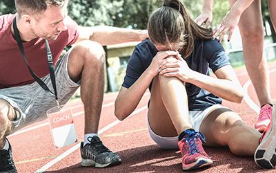 Female athlete getting injured during athletic run training - Ma